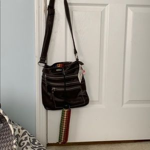 This is a brown crossbody bag with an umbrella !!